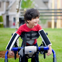 Boy with cerebral palsy smiling and walking